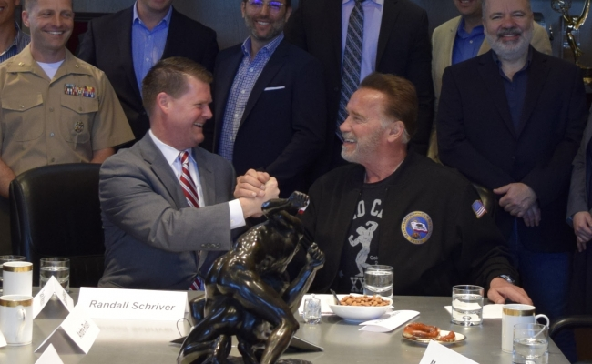 Assistant Secretary of Defense for Indo-Pacific Security Affairs Randall Schriver talks with Governor Arnold Schwarzenegger.