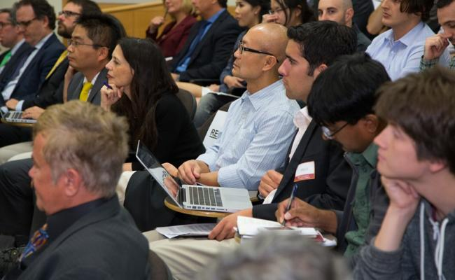 Students and Price faculty engaged in discussion